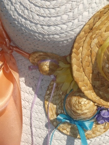 close-up detail of the many hats on the spring hat wreath