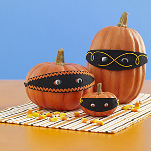 http://www.allyou.com/m/budget-home/crafts/easy-pumpkin-crafts/pumpkin-face-ideas